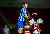 Blackpool's Ben Heneghan battles with Doncaster Rovers' Cameron John<br /> <br /> Photographer Alex Dodd/CameraSport<br /> <br /> The EFL Sky Bet League One - Doncaster Rovers v Blackpool - Tuesday September 17th 2019 - Keepmoat Stadium - Doncaster<br /> <br /> World Copyright © 2019 CameraSport. All rights reserved. 43 Linden Ave. Countesthorpe. Leicester. England. LE8 5PG - Tel: +44 (0) 116 277 4147 - admin@camerasport.com - www.camerasport.com