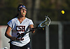 Kate Kotowski #22 of Cold Spring Harbor catches a pass during a non-league varsity girls lacrosse game against Sacred Heart at Cold Spring Harbor High School on Friday, Apr. 1, 2016. Cold Spring Harbor won by a score of 11-9.