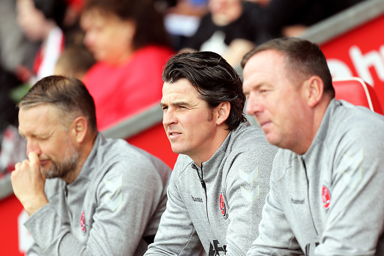 Fleetwood Town manager Joey Barton (Ctr) takes his seat in the dugout with his coaching staff<br /> <br /> Photographer Rich Linley/CameraSport<br /> <br /> The EFL Sky Bet League One - Fleetwood Town v Oxford United - Saturday 7th September 2019 - Highbury Stadium - Fleetwood<br /> <br /> World Copyright © 2019 CameraSport. All rights reserved. 43 Linden Ave. Countesthorpe. Leicester. England. LE8 5PG - Tel: +44 (0) 116 277 4147 - admin@camerasport.com - www.camerasport.com