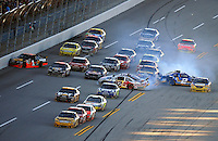 Nov. 1, 2009; Talladega, AL, USA; NASCAR Sprint Cup Series driver Jamie McMurray (26) leads the field as Scott Speed (82), Kurt Busch (2) and Martin Truex Jr (1) crash in a multi car accident during the Amp Energy 500 at the Talladega Superspeedway. Mandatory Credit: Mark J. Rebilas-