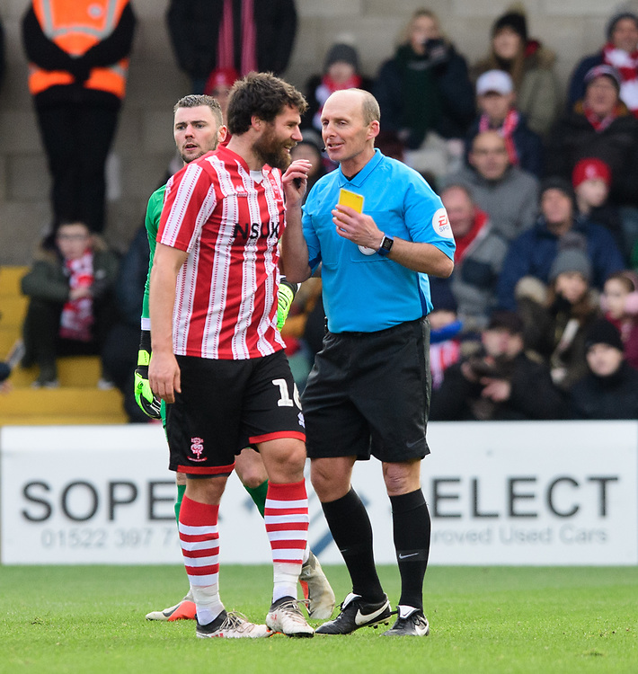 Lincoln City's Michael Bostwick speaks to Referee Mike Dean<br /> <br /> Photographer Chris Vaughan/CameraSport<br /> <br /> The EFL Sky Bet League Two - Lincoln City v Grimsby Town - Saturday 19 January 2019 - Sincil Bank - Lincoln<br /> <br /> World Copyright &copy; 2019 CameraSport. All rights reserved. 43 Linden Ave. Countesthorpe. Leicester. England. LE8 5PG - Tel: +44 (0) 116 277 4147 - admin@camerasport.com - www.camerasport.com