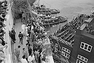 07 May 1969. Passengers aboard the Queen Elizabeth II cruise liner wave and throw streamers while a band plays on the west pier in New York Harbor during the liner's maiden voyage from Southampton, England to New York City.