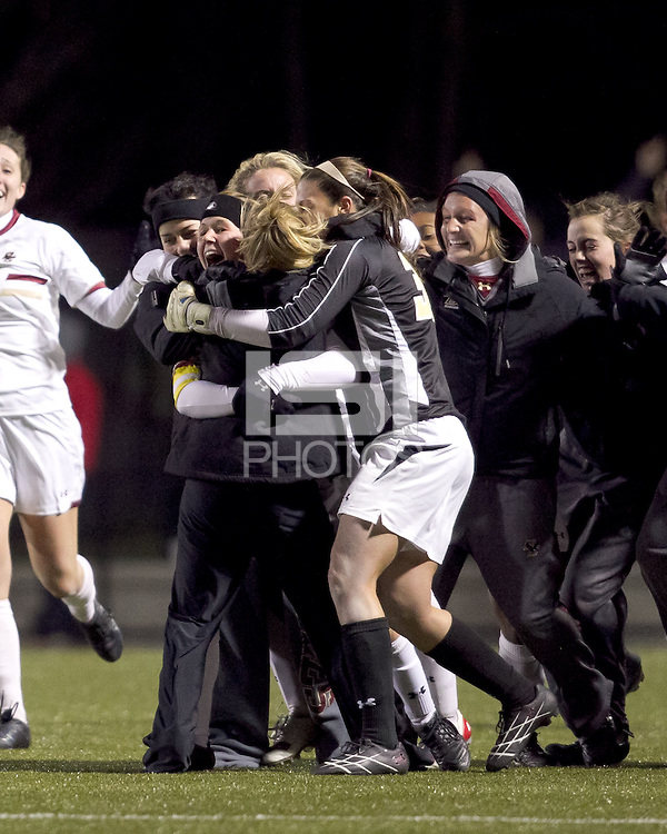"Boston College defender Hannah Cerrone (11) celebrates her goal with teammates. In overtime, Boston College defeated University of Washington, 1-0, in NCAA tournament ""Elite 8"" match at Newton Soccer Field, Newton, MA, on November 27, 2010."