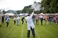 A judge fires the starting gun at an adults' race at the Inveraray Highland Games, held at Inveraray Castle in Argyll.