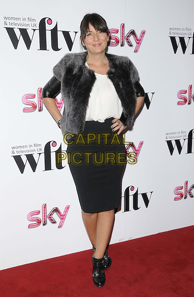 Davina McCall.attended the Sky Women in Film & TV Awards 2012, London Hilton Park Lane Hotel, Park Lane, London, England, UK,.7th December 2012..full length black skirt leather sleeves grey gray fur gilet ankle boots side white top hands on hips .CAP/CAN.©Can Nguyen/Capital Pictures.