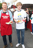 21 December 2018 - Los Angeles, California - Kevin McKidd, Jospeh McKidd. Los Angeles Mission Christmas Meal for the Homeless held at Los Angeles Mission. Photo Credit: F. Sadou/AdMedia