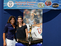 Sara Whalen and Saskia Webber pose with the 1999 FIFA Women's World Cup Trophy, Sky Blue FC defeated the Boston Breakers 1-0 during a Women's Professional Soccer match at Yurcak Field in Piscataway, NJ, on July 4, 2009.