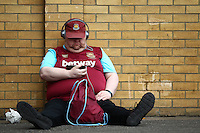 A West Ham United fan listens to the music  before  the Barclays Premier League match between West Ham United and Swansea City  played at Boleyn Ground , London on 7th May 2016