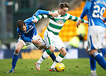 St Johnstone v Celtic...13.12.15  SPFL  McDiarmid Park, Perth<br /> Scott Allan is tackled by Murray Davidson<br /> Picture by Graeme Hart.<br /> Copyright Perthshire Picture Agency<br /> Tel: 01738 623350  Mobile: 07990 594431