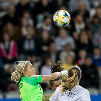 GRENOBLE, FRANCE - JUNE 15: Erin Nayler #1 of the New Zealand National Team punches out a corner kick during a game between New Zealand and Canada at Stade des Alpes on June 15, 2019 in Grenoble, France.
