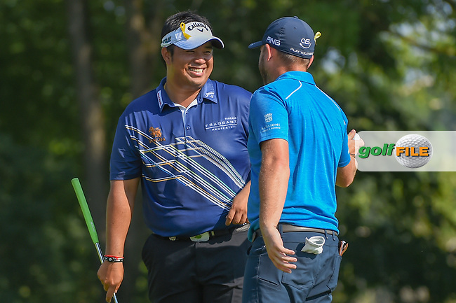 Kiradech Aphibarnrat (THA) celebrates with Andy Sullivan (ENG) after Sullivan's long chip in on 9 during 2nd round of the 100th PGA Championship at Bellerive Country Club, St. Louis, Missouri. 8/11/2018.<br /> Picture: Golffile   Ken Murray<br /> <br /> All photo usage must carry mandatory copyright credit (© Golffile   Ken Murray)