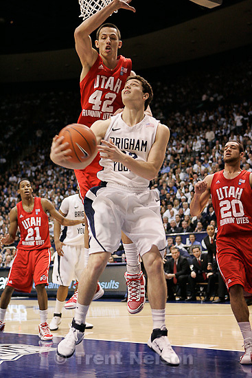 Trent Nelson  |  The Salt Lake Tribune.BYU's Jimmer Fredette shoots with Utah's Jason Washburn defending in the first half at BYU vs. Utah, college basketball in Provo, Utah, Saturday, February 12, 2011.