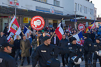 Zum 75. Jahrestag der Reichspogromnacht marschierten bis zu 200 Neonazis von der NPD durch die mecklenburgische Kleinstadt Friedland und protestierten gegen ein geplantes Fluechtlingsheim.<br />Mehrere hundert Gegendemonstranten demonstrierten lautstark gegen den Aufmarsch.<br />300 Polizeibeamte sicherten den reibungslosen Ablauf der NPD-Veranstaltung.<br />Rechts mit Ordnerbinde vor schwarz-weiss-roter Fahne Marko Mueller, NPD-Ordnungsdienst NPD-MV. <br />Links mit braunem Mantel: Udo Pastoers, Fraktionsvorsitzender der NPD im Mecklenburger Landtag und Mitglied im Bundesvorstand der NPD.<br />Mit rundem Plakat: Stefan Koester, NPD-Landtagsabgeordneter MV, NPD-Bundesgeschaeftsfuehrer, Wiking Jugend (WJ).<br />9.11.2013, Berlin<br />Copyright: Christian-Ditsch.de<br />[Inhaltsveraendernde Manipulation des Fotos nur nach ausdruecklicher Genehmigung des Fotografen. Vereinbarungen ueber Abtretung von Persoenlichkeitsrechten/Model Release der abgebildeten Person/Personen liegen nicht vor. NO MODEL RELEASE! Don't publish without copyright Christian Ditsch/version-foto.de, Veroeffentlichung nur mit Fotografennennung, sowie gegen Honorar, MwSt. und Beleg. Konto:, I N G - D i B a, IBAN DE58500105175400192269, BIC INGDDEFFXXX, Kontakt: post@christian-ditsch.de.<br />Urhebervermerk wird gemaess Paragraph 13 UHG verlangt.]