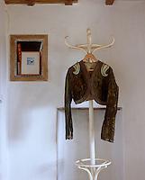 An olive green silk velvet jacket with appliqued shoulder panels