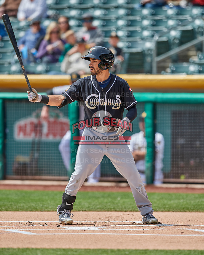 Carlos Asuaje (2) of the El Paso Chihuahuas at bat against the Salt Lake Bees in Pacific Coast League action at Smith's Ballpark on April 30, 2017 in Salt Lake City, Utah.   El Paso defeated Salt Lake 3-0. This was Game 1 of a double-header.(Stephen Smith/Four Seam Images)