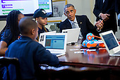 """United States President Barack Obama talks to middle-school students who are participating in an """"Hour of Code"""" event in the Eisenhower Executive Office Building next to the White House in Washington, D.C., U.S., on Monday, December 8, 2014. The event is in honor of Computer Science Education Week. <br /> Credit: Andrew Harrer / Pool via CNP"""
