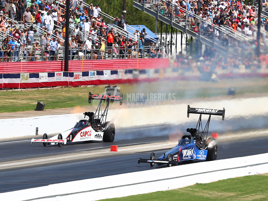 May 6, 2018; Commerce, GA, USA; NHRA top fuel driver Steve Torrence (left) races alongside Blake Alexander during the Southern Nationals at Atlanta Dragway. Mandatory Credit: Mark J. Rebilas-USA TODAY Sports