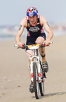 13 JUL 2013 - DEN HAAG, NED - Sam Parker (GBR) of Great Britain cycles along the beach during the 2013 ITU under 23 men's Cross Triathlon World Championships in Kijkduin, Den Haag (The Hague), the Netherlands (PHOTO COPYRIGHT © 2013 NIGEL FARROW, ALL RIGHTS RESERVED)
