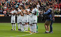 Swansea players applaud in tribute to Swansea president Gwilym Joseph who died during the English Premier League soccer match between Swansea City and Manchester United at Liberty Stadium, Swansea, Wales, UK. Saturday 18 August 2017