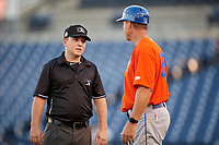 St. Lucie Mets manager Chad Kreuter (29) talks with umpire Brandon Blome during a Florida State League game against the Tampa Tarpons on April 10, 2019 at George M. Steinbrenner Field in Tampa, Florida.  St. Lucie defeated Tampa 4-3.  (Mike Janes/Four Seam Images)