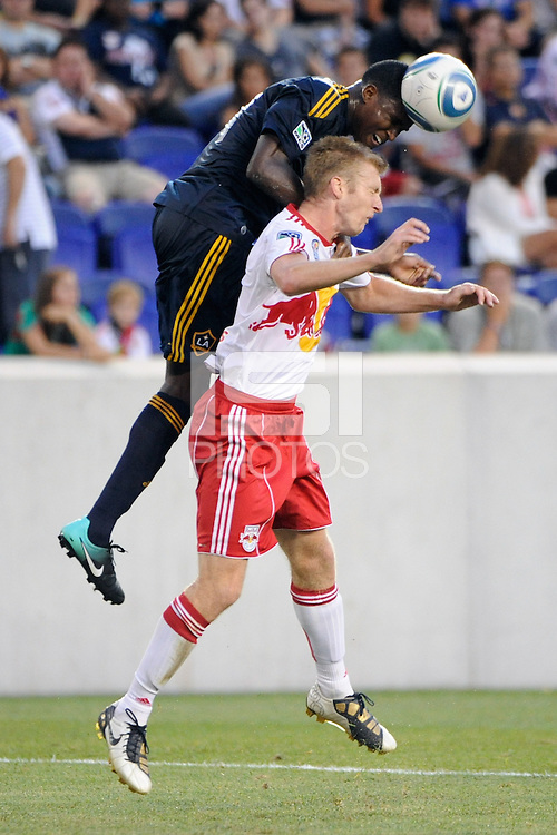 Edson Buddle (14) of the Los Angeles Galaxy heads the ball over Tim Ream (5) of the New York Red Bulls. The Los Angeles Galaxy defeated the New York Red Bulls 1-0 during a Major League Soccer (MLS) match at Red Bull Arena in Harrison, NJ, on August 14, 2010.