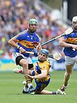 James Barry of Tipperary in action against Shane O Donnell of Clare during their quarter final at Pairc Ui Chaoimh. Photograph by John Kelly.