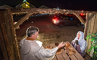 NWA Democrat-Gazette/BEN GOFF @NWABENGOFF<br /> Steven Simpson and wife Cheria Simpson of Cave Springs portray a scene Thursday, Dec. 6, 2018, during a presentation of the 'Bethlehem Revisited' drive-through live nativity scene at Lakeview Baptist Church in Cave Springs. This is the second year the church has done the live nativity scene, with more showings scheduled each night from 6:00 p.m. to 8:00 p.m. though Sunday, weather permitting. A cast of fifty human characters share the spotlight with roughly twenty live animals including horses, goats, chickens and donkeys.