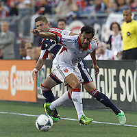 D.C. United forward Carlos Ruiz (20) attempts to control the ball as New England Revolution defender Chris Tierney (8) pressures. In a Major League Soccer (MLS) match, the New England Revolution (blue) tied D.C. United (white), 0-0, at Gillette Stadium on June 8, 2013.