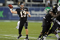 1 September 2011:  FIU's Wesley Carroll (13) passes in the first half as the FIU Golden Panthers defeated the University of North Texas, 41-16, at University Park Stadium in Miami, Florida.