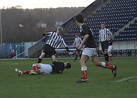 Jack Smith tackled by Kris Faulds at the Falkirk v St Mirren  Scottish Football Association Youth Cup 4th Round match played at the Falkirk Stadium, Falkirk on 16.12.12. .