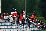 18 April 2015: A small group of traveling Atlanta Supporters with flags and banners supporting their team. The Carolina RailHawks hosted the Atlanta Silverbacks at WakeMed Stadium in Cary, North Carolina in a North American Soccer League 2015 Spring Season match. Atlanta won the game 2-1.