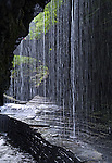 The Bridal Falls in Watkins Glen State Park falls onto a ledge on one side of the stream and visitors, willing to get a little wet, can carefully walk under the falls on the opposite ledge. This photograph was taken with a fast shutter speed.