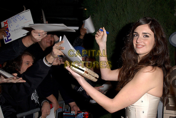 "PAZ VEGA .attends Columbia Pictures' Los Angeles Premiere of ""Spanglish"" held at The Mann's Village Theatre in Westwood, California, USA,December 9th 2004..half length signing autographs fans.Ref: DVS.www.capitalpictures.com.sales@capitalpictures.com.©Capital Pictures."