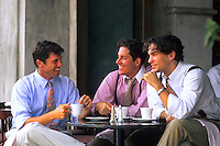 Attractive businessmen and friends in their 20s and 30s  relaxing and having coffee in a local cafe