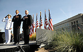 United States President Barack Obama flanked by U.S. Secretary of Defense Robert Gates and Chairman of the Joint Chiefs of Staff Michael Mullen participate in a wreath laying ceremony and moment of silence at the Pentagon Memorial to mark the 9th anniversary of the terrorist attacks, in Arlington, Virginia, Saturday, September 11, 2010..Credit: Olivier Douliery - Pool via CNP