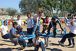 MEXICAN SCHOOL CHILDEN HAVE FUN ON SWING