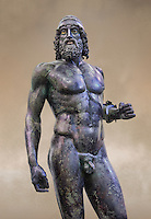 Torso face on view of the Riace bronze Greek statue A cast about 460 BC. statue A was probably sculpted by Myron. The style of the Riace statues straddles the archaic period and heralds the start of the classical period. Both statues depict strong young naked warriors who stand calmly but exuding great power. Museo Nazionale della Magna Grecia,  Reggio Calabria, Italy.