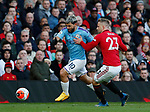 Sergio Aguero of Manchester City runs past Luke Shaw of Manchester United during the Premier League match at Old Trafford, Manchester. Picture date: 8th March 2020. Picture credit should read: Darren Staples/Sportimage