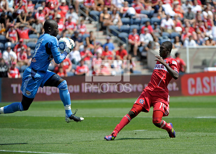 New York goalkeeper Bouna Coundoul (18) makes the save in front of Chicago midfielder Patrick Nyarko (14).  The Chicago Fire tied the New York Red Bulls 1-1 at Toyota Park in Bridgeview, IL on June 26, 2011.