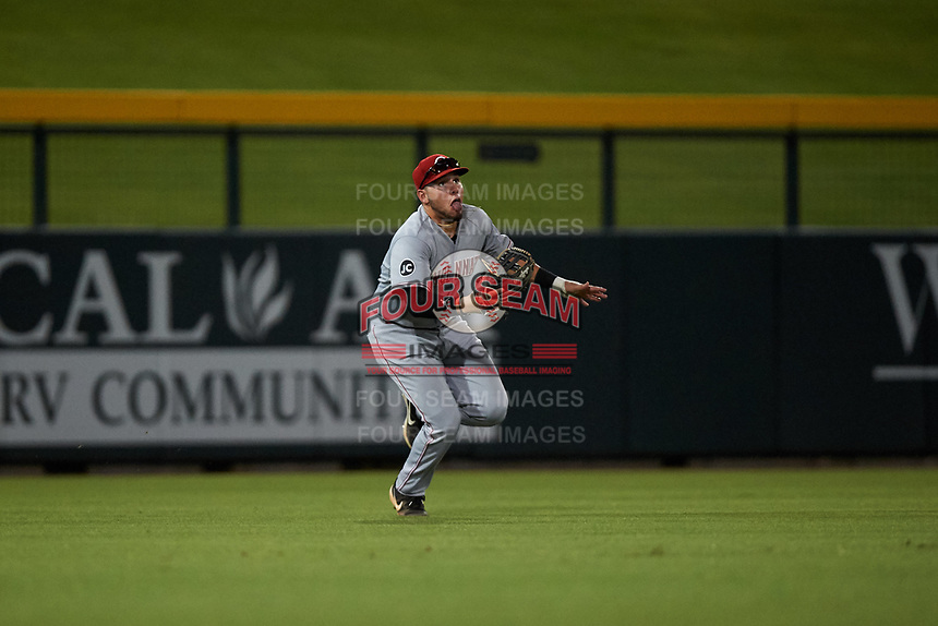 AZL Reds left fielder Wendell Marrero (31) pursues a shallow pop fly during an Arizona League game against the AZL Cubs 2 on July 23, 2019 at Sloan Park in Mesa, Arizona. AZL Cubs 2 defeated the AZL Reds 5-3. (Zachary Lucy/Four Seam Images)