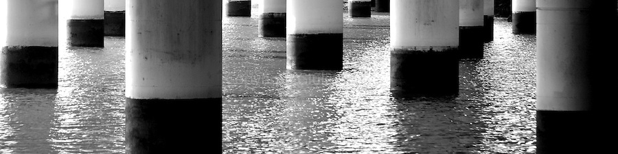 The pylons of the Riverside Expressway that runs along the edge of the Brisbane CBD, sit in the waters of the Brisbane River.