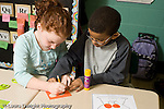Education Elementary school Grade 2 mathematics boy and girl working together on project horizontal