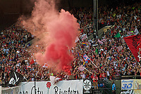 Portland, Oregon - Sunday September 11, 2016: Thorns supporters celebrate after a goal during a regular season National Women's Soccer League (NWSL) match at Providence Park.
