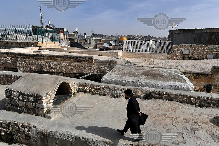 An Orthodox Jew walks in the 'Rooftops of the Markets' area in Jerusalem's old city.