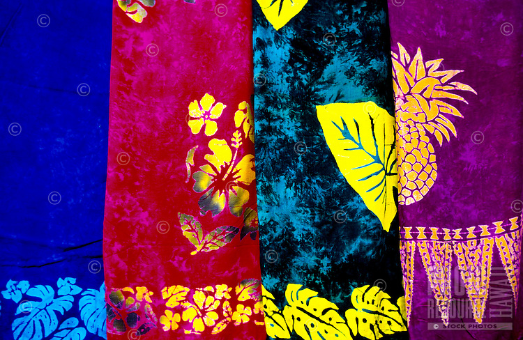 Colorful garments for ladies, on display in open shops, catch the eyes of vistors to Hawaii.
