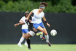 18 September 2011: Florida State's Jamia Fields (4) pulls the jersey of Duke's Gilda Doria (21). The Duke University Blue Devils defeated the Florida State University Seminoles 2-1 at Koskinen Stadium in Durham, North Carolina in an NCAA Division I Women's Soccer game.