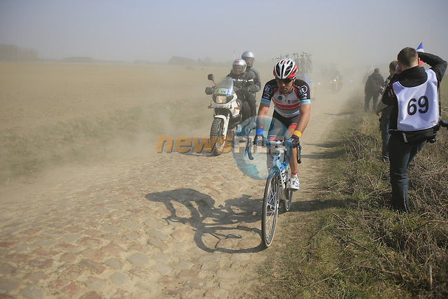 Yaroslav Popovytch (UKR) Radioshack Leopard Trek battles his way through the dust kicked up by team cars on pave section 11 d'Auchy a Bersee during the 111th edition of the 2013 Paris-Roubaix cycle race, France 7th April2013 (Photo by Eoin Clarke 2013)