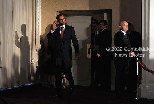 Washington, DC - March 12, 2009 -- United States President Barack Obama arrives to speak to members of the Business Roundtable at the St. Regis Hotel in Washington on Thursday, March 12, 2009. .Credit: Roger L. Wollenberg - Pool via CNP