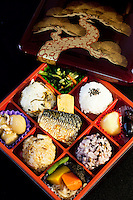 "Shokado Bento - The origin of bento can be traced back to the Kamakura Period when cooked and dried rice called hoshi-ii literally ""dried meal"" was developed. In the Edo Period bento culture spread and became more refined. Bento became even more popular in the 80s with the help of the microwave and the proliferation of convenience stores. The expensive wood and metal boxes have been replaced at most bento shops with inexpensive, disposable plastic ones Even handmade bento have made a comeback, and they are once again a common sight at picnics."