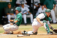 April 23, 2011:    Stetson Hatters lf Jeff Simpson (3) slides by Jacksonville University Dolphins catcher Alex Swenson (14) to score a run in the first inning during Atlantic Sun Conference action between Stetson Hatters and Jacksonville University Dolphins at John Sessions Stadium in Jacksonville, Florida.  Jacksonville defeated Stetson 10-4...........
